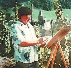 Ein Winzer malt mit seinem Wein: Heinz Ames bei der Arbeit im Weinberg.